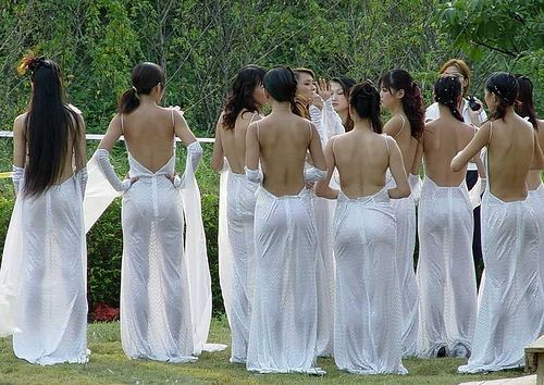 Girls with sexy bare backs, slim sexy curvy hot bodies, and perky juicy bouncy butt cheeks poses in white see-through gowns