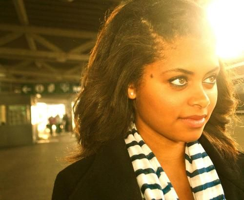Pretty light-eyed ebony with juicy lips poses in black/white striped scarf and black jacket
