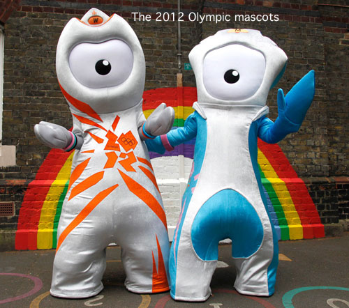 Two people pose in 2012 Olympic Mascots blue/white/orange costumes