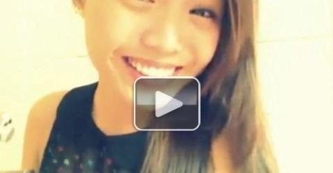 Pretty Asian brunette in black top
