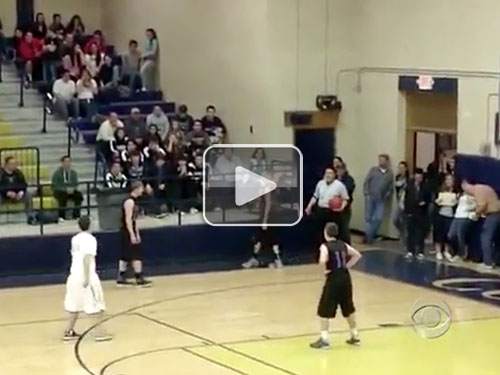 lead30 High school basketball player passes ball to mentally challenged player on the other team so he can score a basket (Video)
