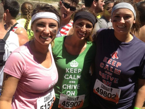 girls in keep calm shirts running a race or marathon with black face paint