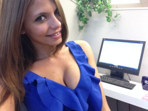 Pretty blonde with perky juicy boobs takes selfie in cleavage showing blue top