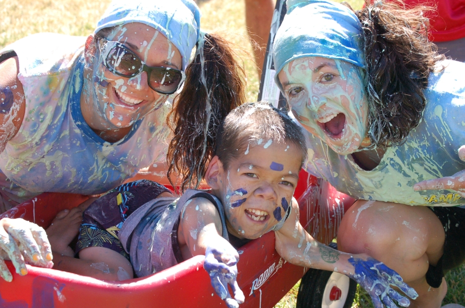 ChiveCharities The Painted Turtle girls covered in paint pose with Josh Burger