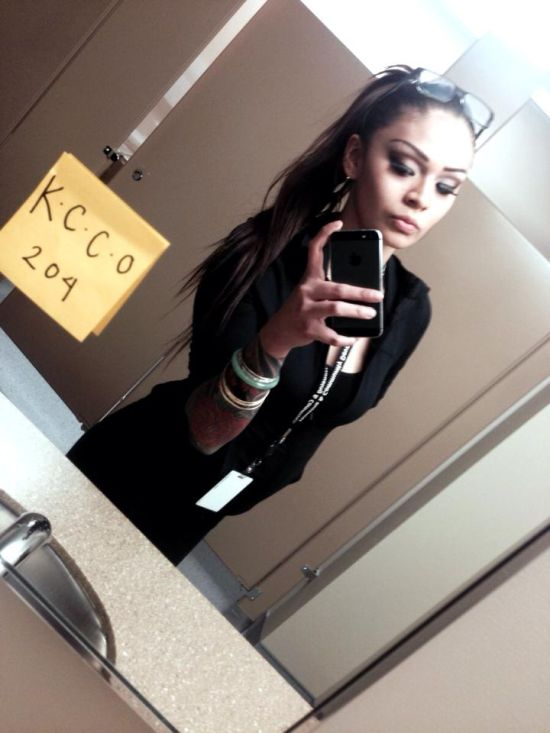 Brunette with slim sexy body in black dress takes selfie with KCCO sign