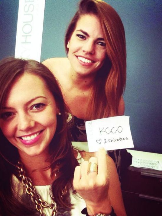 Brunettes with juicy lips and flowing tresses take selfie in black and white tops with KCCO Chivettes sign