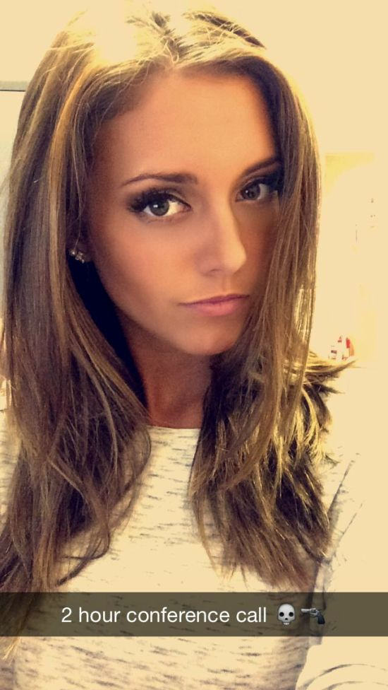 Pretty blonde with flowing tresses takes selfie in white top
