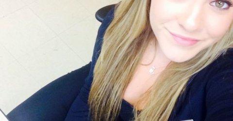 selfie of blonde girl at her desk