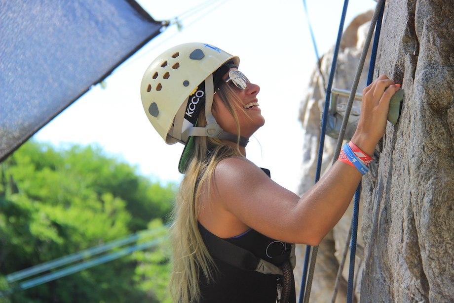 cute blonde rock climbing with KCCO on helmet