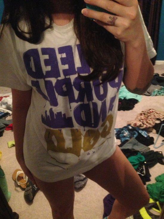 Brunette with slender legs takes selfie in white tee in messy room