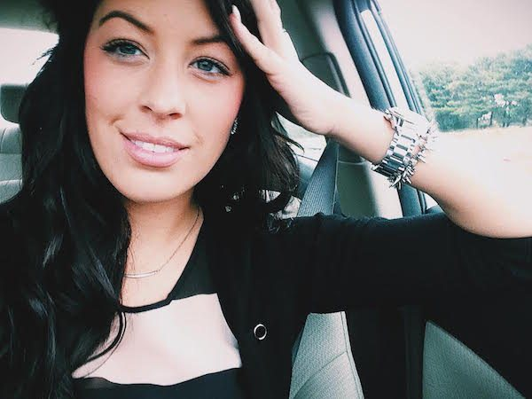 Girl smiling in car
