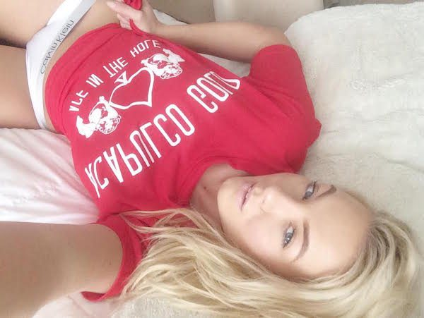 Blonde selfie girl in red shirt
