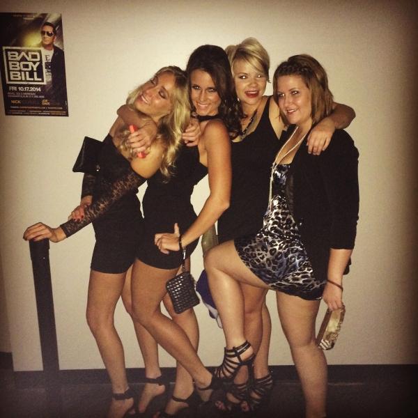 4 girls in black dresses
