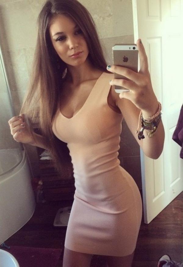 Girl in tight tan dress