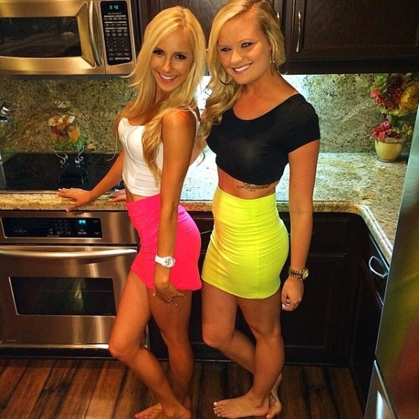 Blonde girls in pink and yellow tight skirts