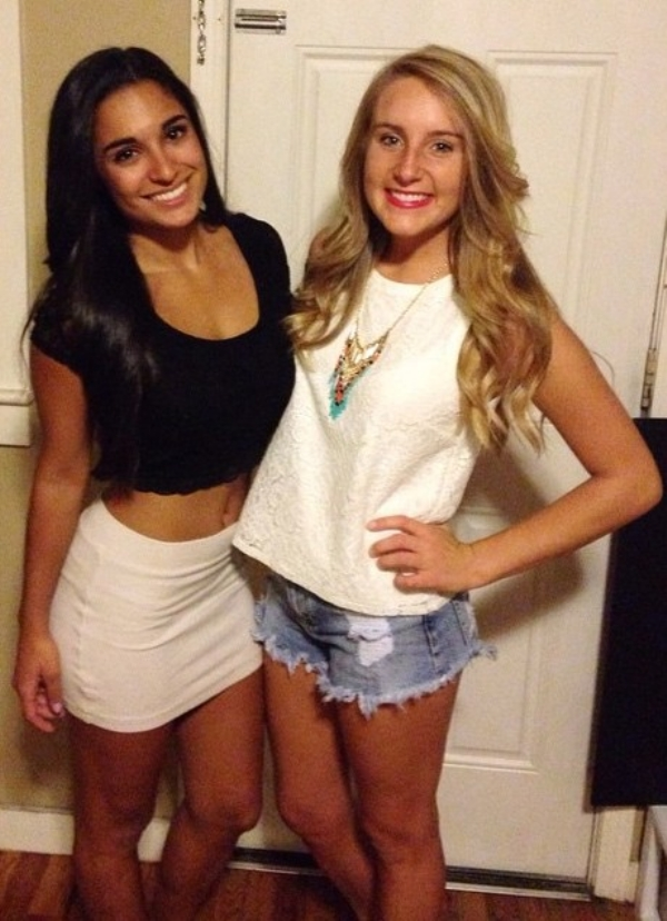 Girl in black top and white skirt with girl in short jean shorts