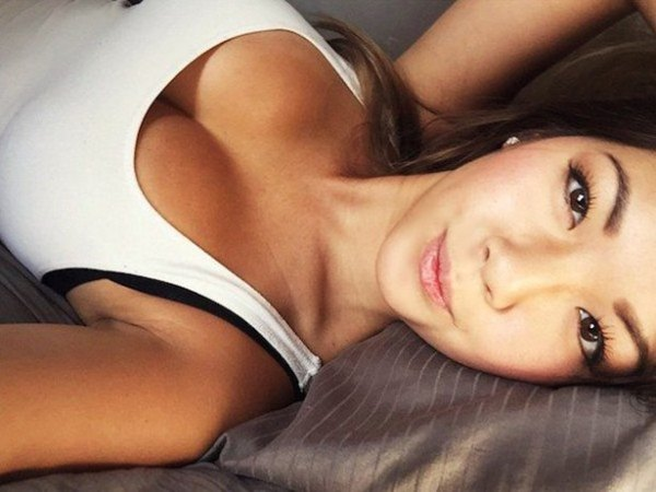 Asian girl laying down with white tank top