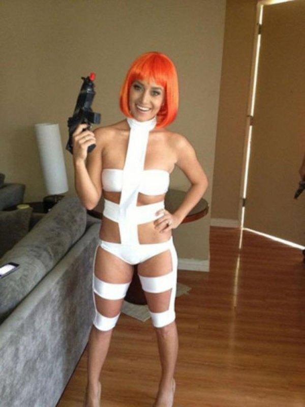 Girl with orange hair and gun