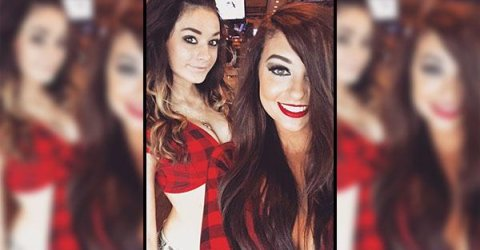 Pretty light-eyed brunettes with juicy lips, supple big bouncy boobs and slim sexy curvy hot body pose for selfie in red/black cleavage showing knotted shirt