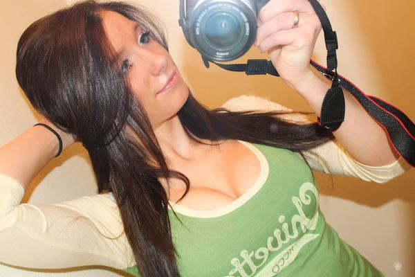 Pretty brunette with perky juicy boobs poses with camera and takes selfie in white/green Chivette top
