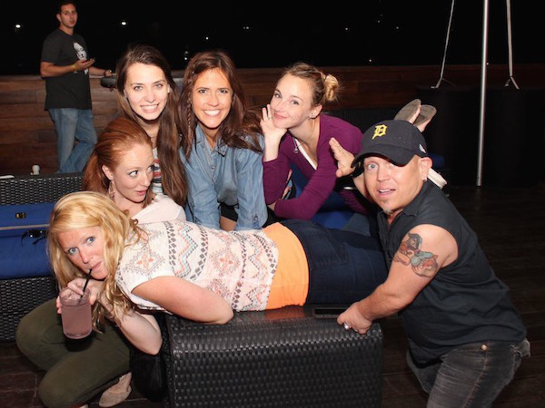 hot girls hanging out with a midget in a detroit baseball cap drinking alcohol