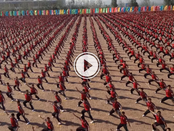 36,000 Kids from the Shaolin Temple Kung Fu Academy performing something amazing .