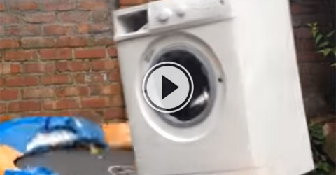 A brick inside a washing machine tied to a trampoline (Video)