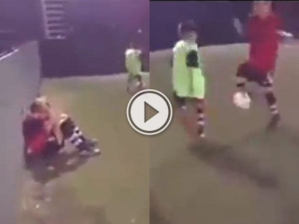 Boy gives up after being beaten by an amazing bit of skill.