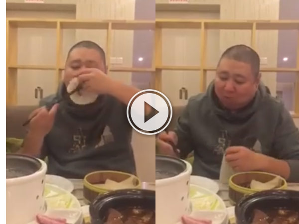 This guy has got the best way to eat Peking Duck ever.