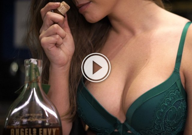 Brunette with juicy supple boobs poses in green lace bra