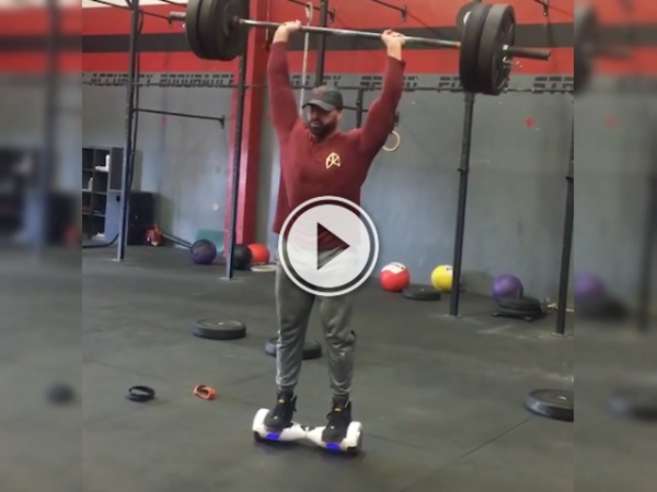 Can you balance on a hoverboard and lift weights? This guy can! (Video)