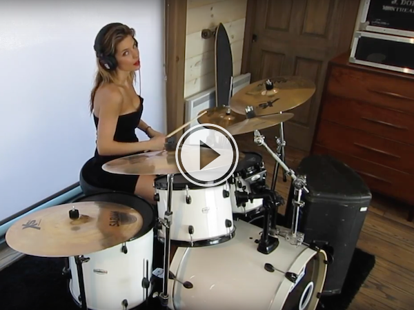 Cute girl, hot dress, playing the drums like a beast! (Video)