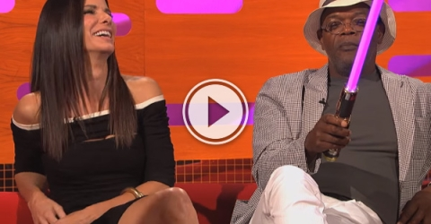 Samuel L. Jackson chats about his purple light sabre and Graham gives him a toy one to play with.