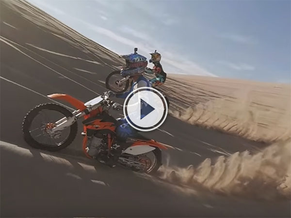 Dirt bike sand dune jumping (Video)