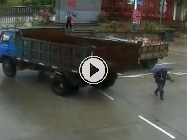 Near miss between truck and man in China (Video)