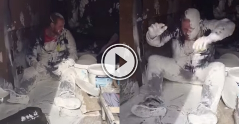 Painter and decorator has a very bad day at the office and paint is everywhere.