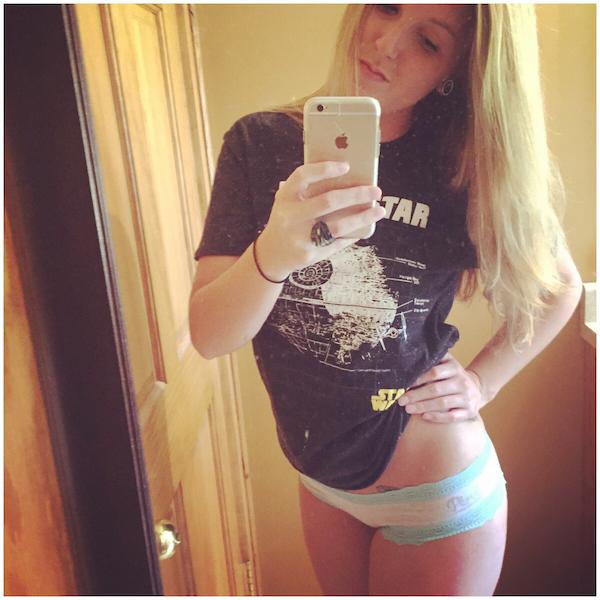 Blonde taking selfie in a Star Wars tshirt