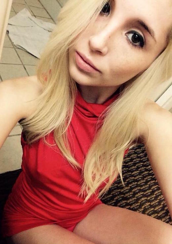 Blonde with perky tits and slim sexy body takes selfie in nipple showing little red turtleneck dress