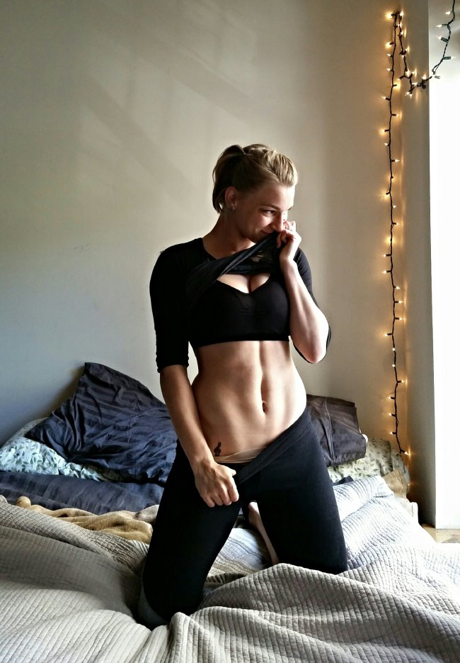 Blonde with hot voluptuous body and perky boobs in black bra tugs black yoga pants and flaunts sexy ripped abs