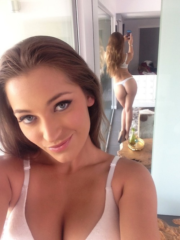 Cute light-eyed brunette Dani Daniels with big supple juicy boobs, sexy curvy body, and big bouncy juicy butt cheeks takes selfie in white lingerie