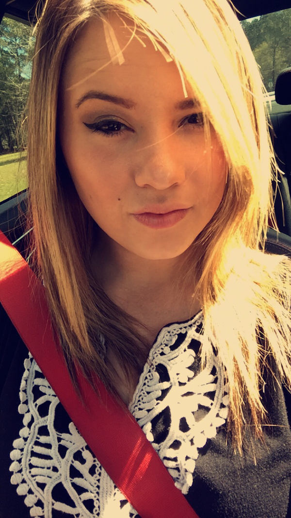 Girl clicks a selfie in the car with her seat belt ON