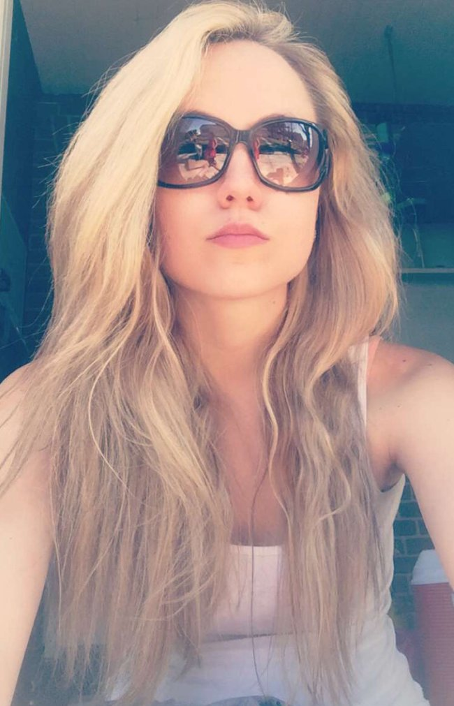 Sexy blonde with big sunglasses taking selfie with open hair