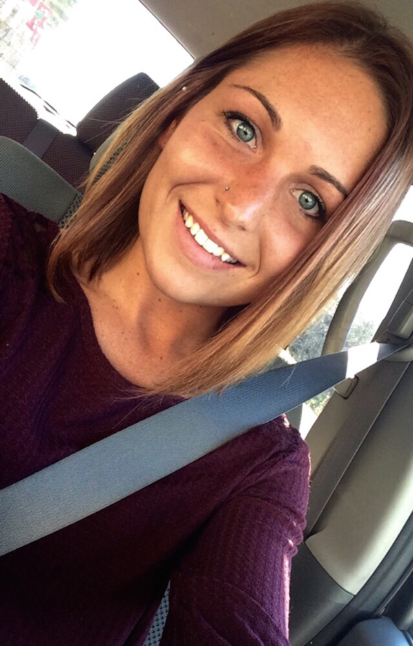 Hot blue eyed girl clicks a car selfie as she smiles