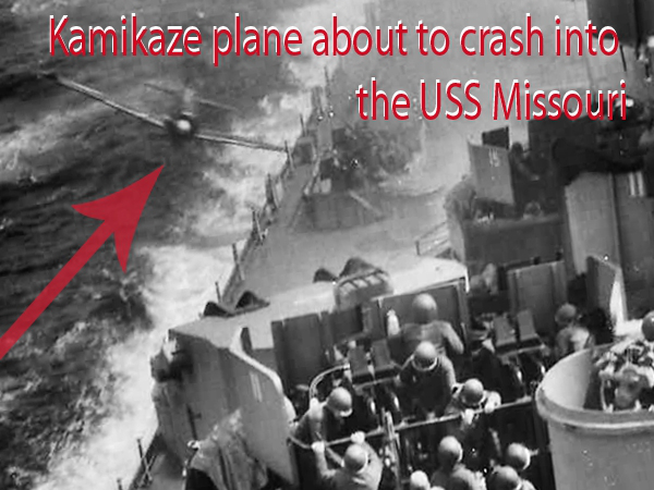 An old black and white picture of Kamikaze Plane about to crash into a battleship of USS Missouri