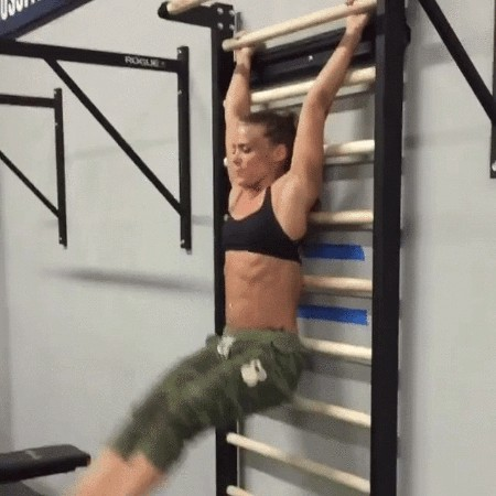 strong girl working out in gym to make her belly abs. gif