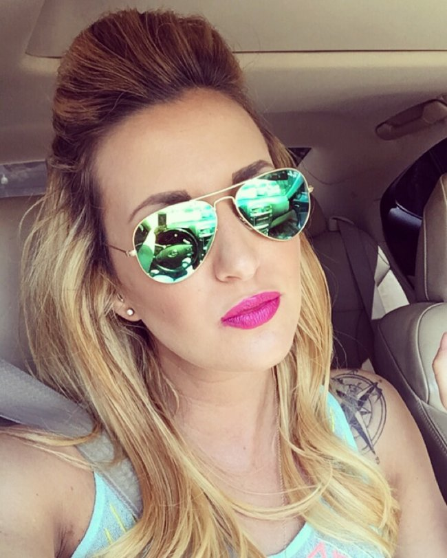 Sexy pink pout,big puff and hot sunglasses make the perfect selfie