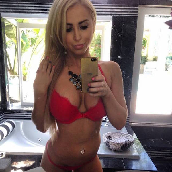 Blonde with big round supple boobs and slim sexy body takes selfie in red bra and panties
