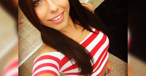 Gorgeous brunette with beautiful light eyes and juicy full lips takes selfie of perky tits and slim sexy body in red/white striped crop top and blue denim shorts