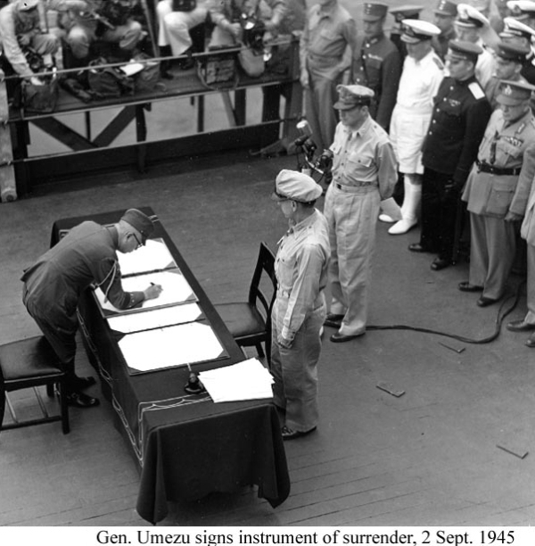 A historic photograph of Gen.Umezu signing the instrument of surrender on Sept.2, 1945.