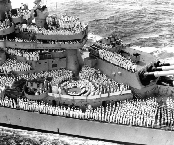 A photograph of the entire USS Missouri Crew, assembled on the deck